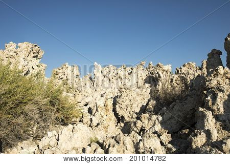 Tufa Rock Formations Against Blue Skies
