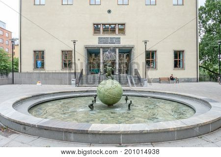 STOCKHOLM, SWEDEN - JULY 4, 2017: The Eastman institute and the Eastman fountain in Stockholm.  The institute was donated by George Eastman to provide free dental care to children.