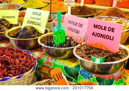 Different types of mole and spices in marketplace in downtown Oaxaca Mexico