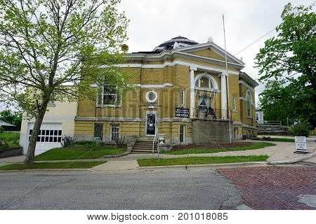 CADILLAC, MICHIGAN / UNITED STATES - MAY 31, 2017:  The historic building of the Cadillac Carnegie Public Library now houses the Wexford County Historical Society Museum.