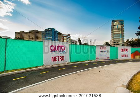 Quito, Pichincha Ecuador - August 10 2017: Beautiful view of the metro construction located inside of the Carolina park, covered the working area with a green protection, at north part of the city of Quito.