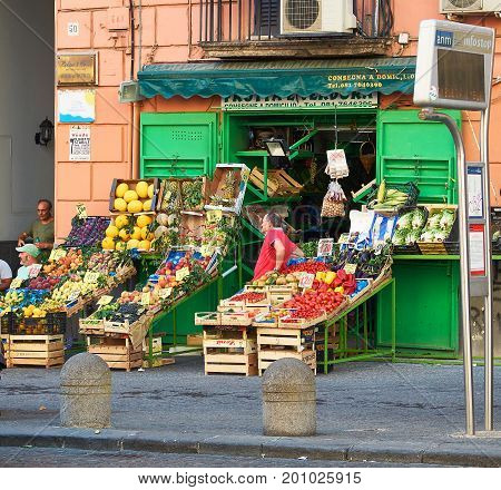 Naples Italy - August 7 2017. People in front of a greengrocer in downtown of Parma. Naples. Campania Italy.