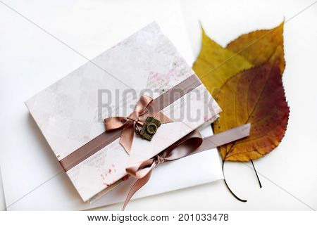 Autumn Gift In Craft Paper And Dry Leaves