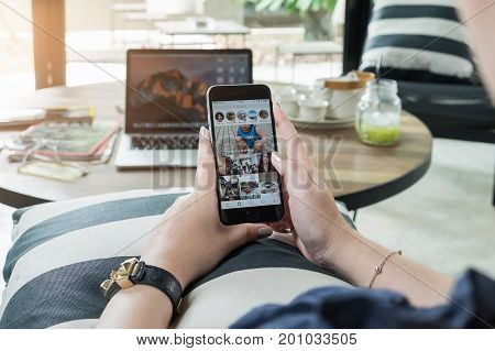 CHIANG MAI THAILAND - AUG 15 2017: A woman hand holding iphone with search page of instagram application. Instagram is largest and most popular photograph social networking.