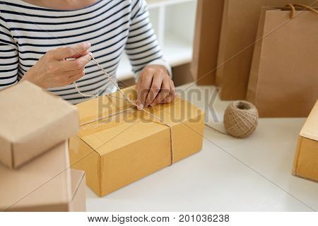 Teenager Owner  Work At Home For Online Shopping Preparing Package The Product With Office