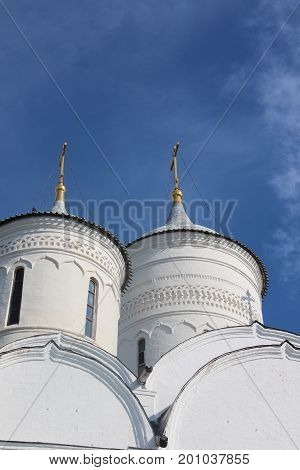Courtyard of Spaso-Prilutsky Monastery in the Vologda city, Russia. Summer sunny day. White church. Top part of the building