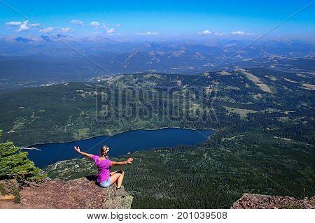 Girl hiker enjoying an amazing view from Table mountain, Alberta, Canada