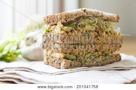 Chickpea Sandwiches with garlic sauce and avocado