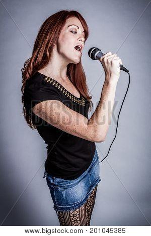Beautiful pretty redhead singing woman