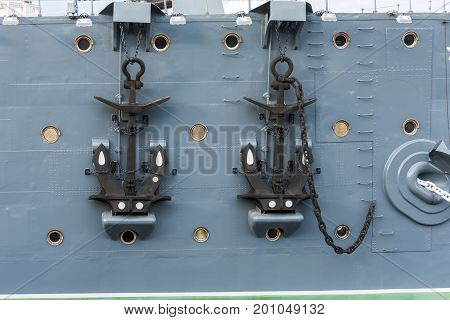 Raised anchors of a military cruiser close up