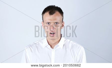 Young man surprised shocked after crisis, White Background