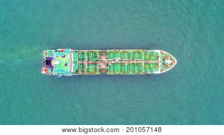 oil tanker gas tanker in the high sea.Refinery Industry cargo ship. top view aerial view Thailand in import export LP Goil refinery Logistics and transportation with working crane bridge in harbor