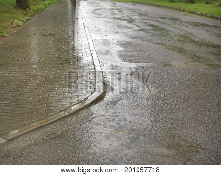 Slippery tiled footpath in a rainy day outdoor cropped photo