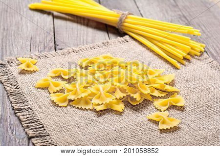 Italian pasta made from durum wheat on a wooden background