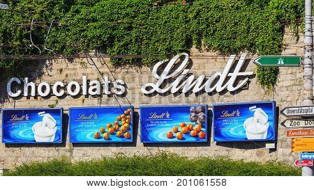 Zurich, Switzerland - 20 June, 2016: advertisement of Chocolats Lindt on a stone wall at Central square. Lindt is a brand of theLindt & Sprungli AG - a Swiss company founded in 1845.