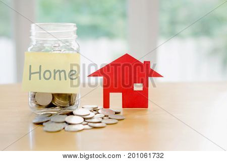 Home budget concept. home money savings in a glass