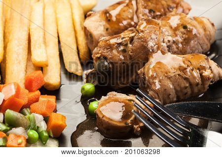 Pork Rolls With French Fries With Vegetable
