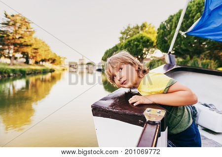Cute little boy sailing on the boat. Image taken in Aigues-Mortes Camargue in Languedoc-Roussillon France