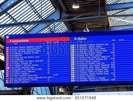 Zurich, Switzerland - 18 June, 2017: arrival/departure display at the Zurich main railway station. Zurich railway train station is the largest railway station in Switzerland.