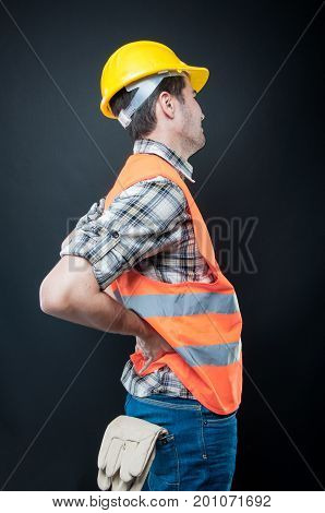 Side View Of Constructor Holding Back Like Hurting