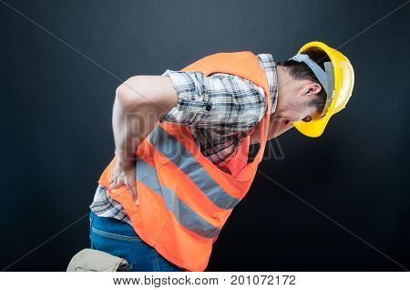 Constructor Holding Back  And Bending Over Like Hurting
