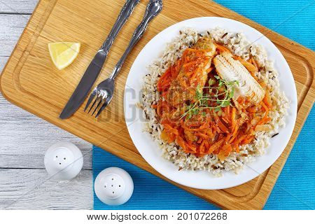 Portion Of White Fish And Rice