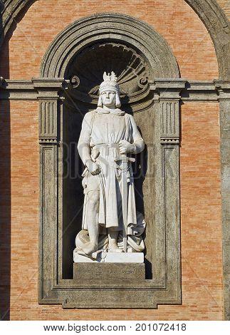 Statue of Federico II di Svevia (Frederick II Holy Roman Emperor) in the principal facade of Palazzo Reale di Napoli in Piazza del Plebiscito. Naples. Campania Italy. poster