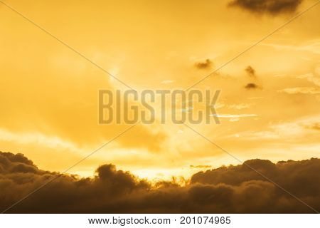 Background of storm clouds before a thunder-storm During this period beautiful golden yellow sunset.