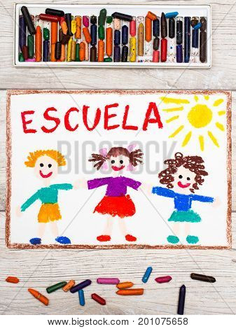 Photo of colorful drawing: Spanish word SCHOOL and happy children. First day at school.