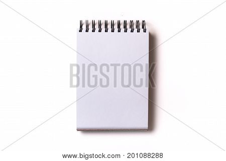 Vertical aligned isolated notebook mock up with blank white sheets on white background. Top view flat lay.