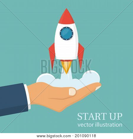 Start up concept. Businessman holds a flying rocket in hand, symbol of start of project's launch. Vector illustration cartoon flat design. Isolated on white background. Business metaphor.