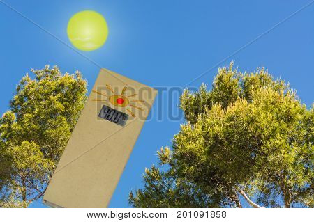 Thermometer in the sun shows 40 degrees. Concept hot summer day and high outside temperatures against a blue sky.