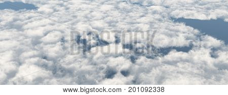 Computer generated 3D illustration with the aerial view of cumulus clouds