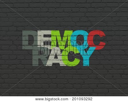Politics concept: Painted multicolor text Democracy on Black Brick wall background