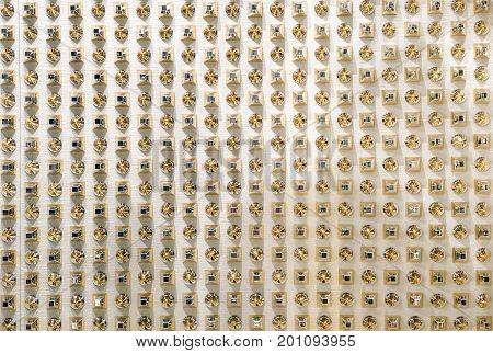 Canvas of crystal rhinestones. Golden rhinestones texture