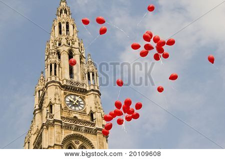 Many red balloons in front of the town hall in Vienna