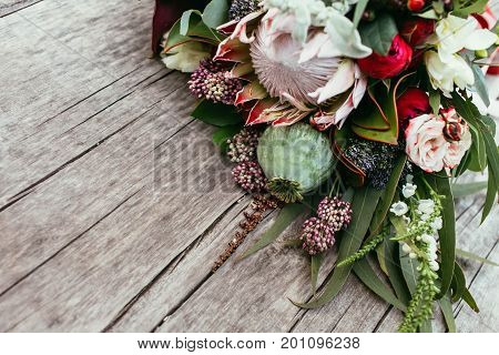 Rustic Wedding Bouquet With White And Bordeaux Roses, Peonies, Poppy And Greens On An Aged Wooden Fl