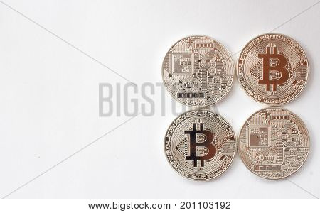 On a white background are silver coins of a digital crypto currency - Bitcoin. It's the back and face of the coin of a fictitious crypto currency bitcoin with free text space.