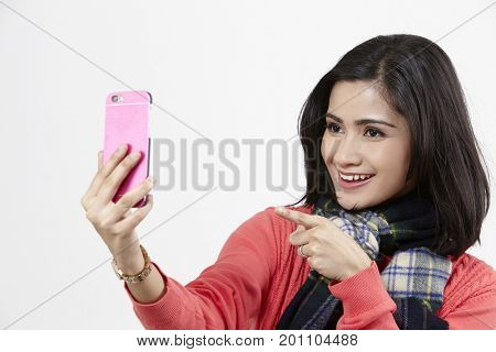 malay woman using smart phone on the white background