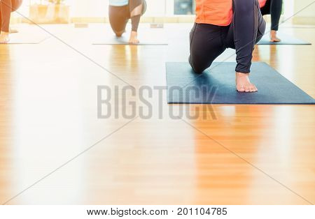 Close up feet of yoga class stretching on mat at studio classroomhealthy lifestyle sport