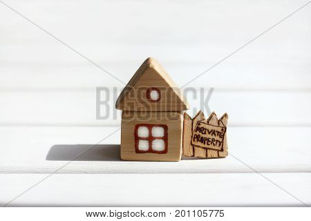 Installation of a small house with a fence and an advertisement / private property