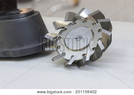 The CNC special milling cutter on the floor..Cutting tool for CNC process.