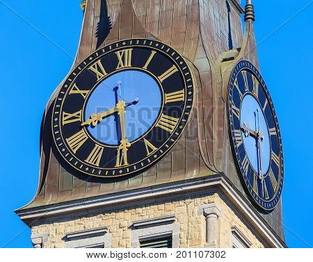 Clock on the tower of the St. Jakob Church in the city of Zurich Switzerland.