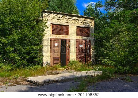 The old abandoned transformer building in the zone. Dead military unit. Consequences of the Chernobyl nuclear disaster August 2017.