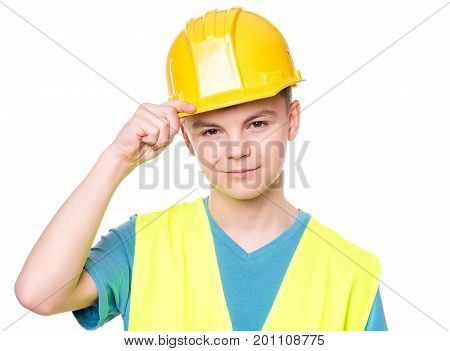 Emotional portrait of handsome teen boy wearing safety jacket and yellow hard hat. Happy child looking at camera, isolated on white background. Funny cute guy - construction worker or architect.