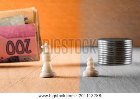Wealth and poverty king and pawn chess pieces symbolizing people with different statuses and different levels of earnings