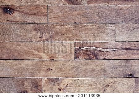 Old damaged hardwood maple floor found in a very old home during renovations. Image shot from above.