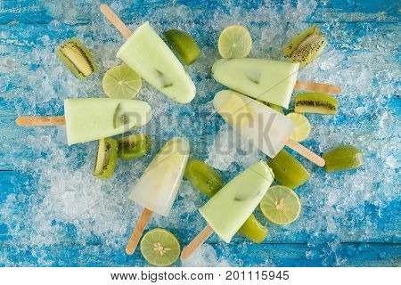 Crushed Ice Cubes And Lemon, Kiwi, Homemade Ice Cream On Vintage Blue Wooden Table. Top View