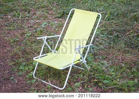 Folding chair - chaise lounge for relaxing in in camping