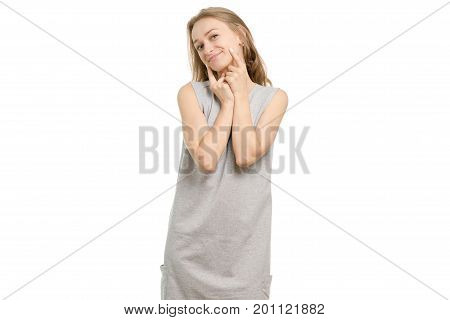Beautiful young girl showing on dimples on white background isolation